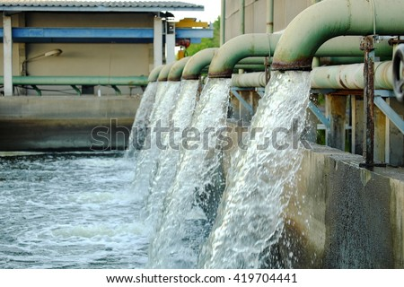 Water flows from a pipe for cooling of machine. - stock photo