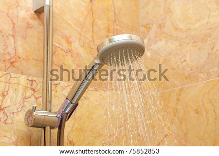 Water flows from a shower head - stock photo