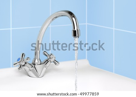 water flows from the tap - stock photo