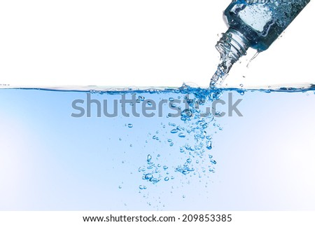 Water flows out of a bottle, creating bubbles against a white background