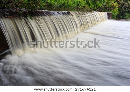Water flows over the weir at Coote Creek Wattamolla, Royal National Park, Australia - stock photo