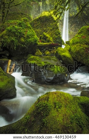 Water flows through the boulders under Elowah Falls in Oregon.