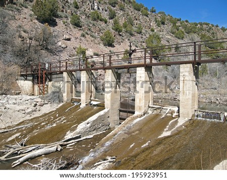 Water flows through the gates of a rural irrigation system. - stock photo