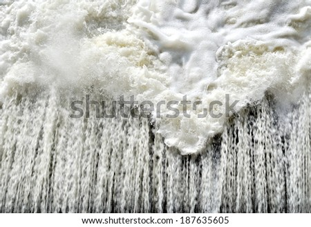 water flows under pressure at hydroelectric dams - stock photo