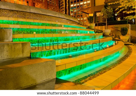 Water fountain made of stone steps and lights