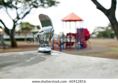 water fountain with a park and trees in background - stock photo