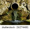 Water from old pipe - stock photo