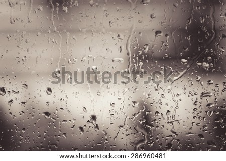 Water from rain on glass - stock photo