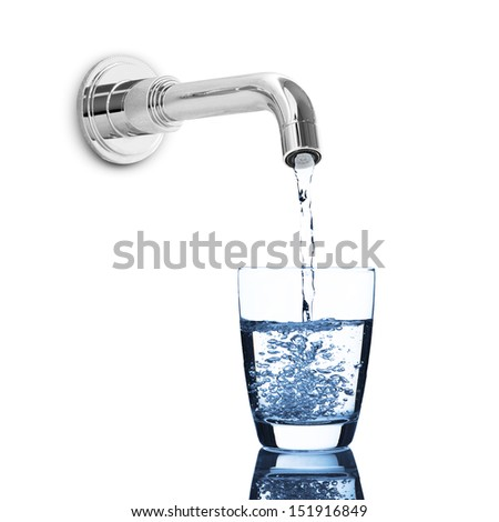 Water from tap pouring into water glass - stock photo