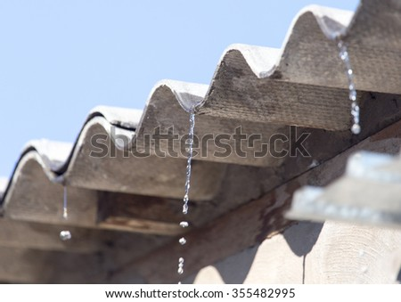 Water from the roof of the house - stock photo