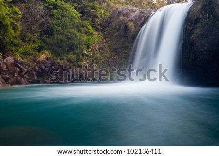 Water from volcano Mt Ruapehu forms Tawhai Falls in Tongariro National Park, New Zealand - stock photo