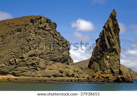 Water front cliffs and rocky projections in the Galapagos Islands - stock photo