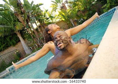 Water fun in a summer pool - stock photo