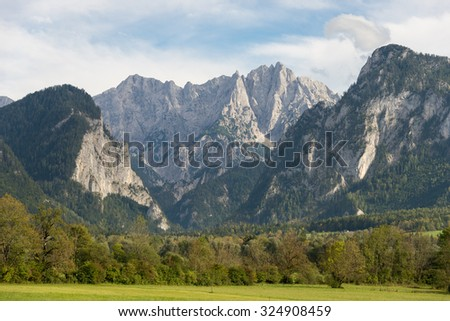 Water gap from the Gesaeuse mountain range and view into the Enns valley and the Hochtor massif. The Gesaeuse range is part of the Ennstal Alps and a national park in Styria, Austria  - stock photo