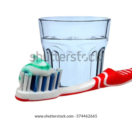 Water glass with toothbrush - stock photo