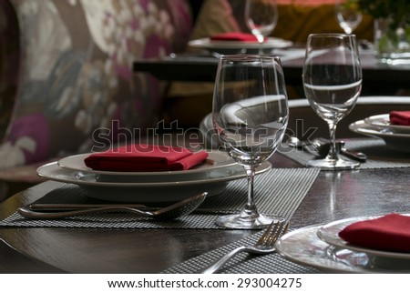 water glasses on table with other eating utensil - stock photo