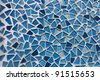 Water going down the mosaic glass wall texture decoration background - stock photo
