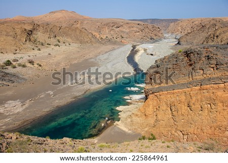 Water has cut through desert rock to create Wadi Dyqah, one of the most beautiful natural landscapes in the Sultanate of Oman. - stock photo