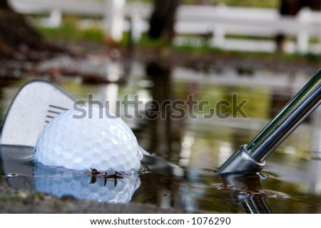 Water hazard on the golf course. Playing out of the water. - stock photo