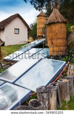 water heater with a solar battery - stock photo
