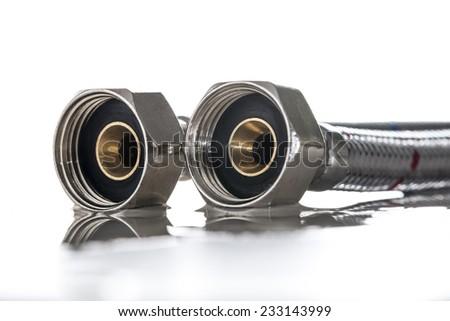 Water hose in metallic braiding - stock photo