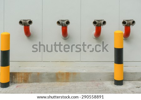 water hoses and fire extinguish equipment - stock photo