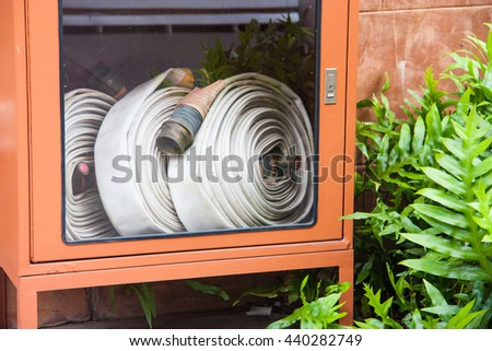 water hoses and fire extinguish equipment in the garden - stock photo