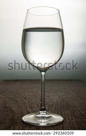Water in glass on wood table. - stock photo