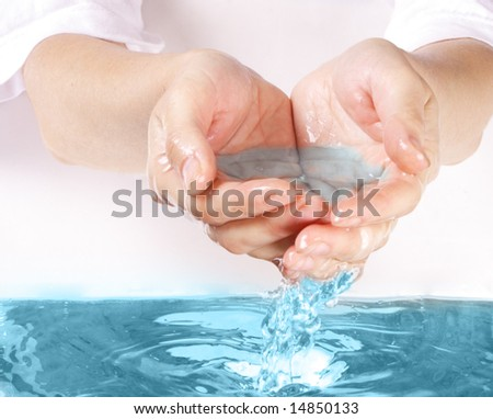 water in hand - stock photo