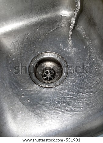 Water in stainless steel sink