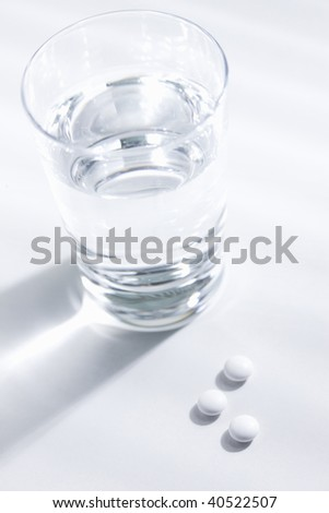Water in the glass of glass and some medicine.