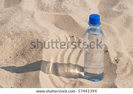 water in the sand - stock photo