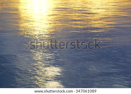 Water in the sea reflection sunlight in the morning,abstract pattern blurry image:select focus with shallow depth of field:ideal use for background. - stock photo