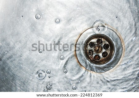 water in the sink - stock photo