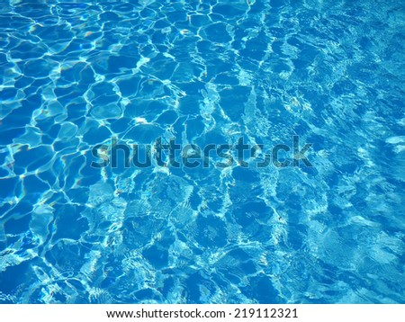 Water in the swimming pool with a wave - stock photo