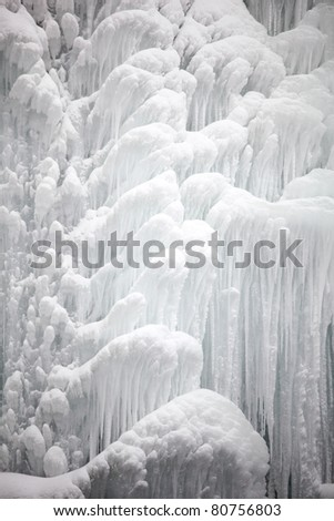 Water in waterfall is frozen under an extreme cold weather - stock photo
