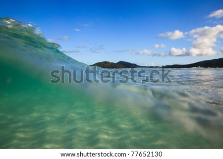 water incoming wave cover white sand silica beach clear transparent sea edge of surf blue sky - stock photo