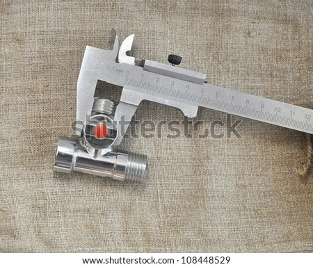 water inlet valve on a background of bagging - stock photo