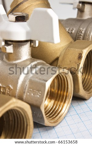 water inlet valve pump system on a background of graph paper - stock photo
