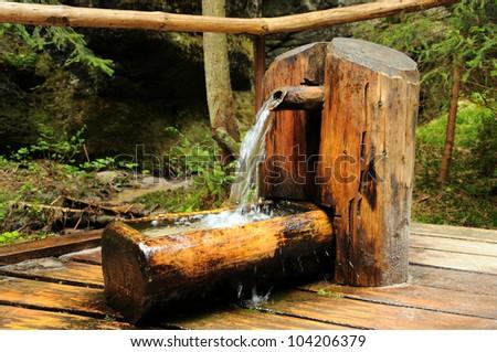 Water intake point. Adrspach-rock city of Teplice. Czech Republic - stock photo