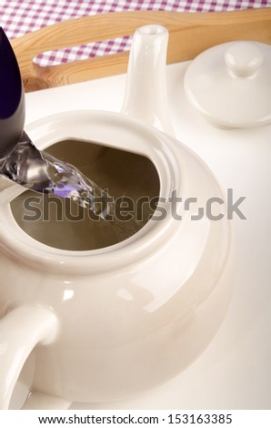 water is filled into a teapot