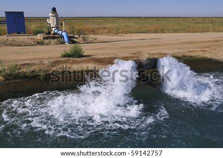 Water is pumped into California irrigation canal - stock photo
