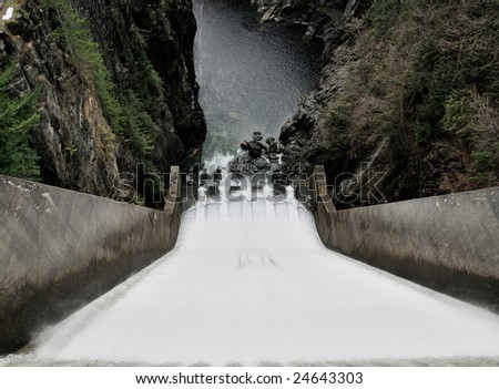 Water is rushing down Cleveland Dam drain by Capilano Lake, Vancouver, British Columbia. - stock photo