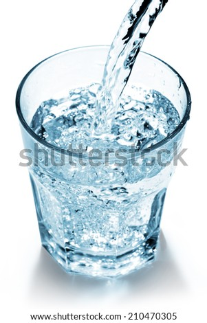 water jet filling a glass on white background - stock photo