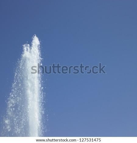 water jet in blue sky - stock photo