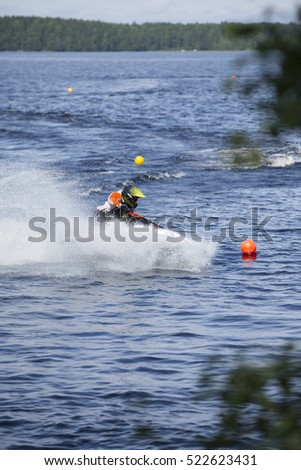 Water jet or personal water craft running fast and splashing the water on a  sunny day.