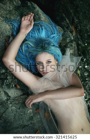 Water lady posing on stream stones . Fantasy and myth - stock photo