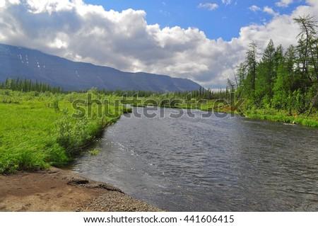 Water landscape wildlife Taimyr. Mountain river on the Putorana plateau. - stock photo