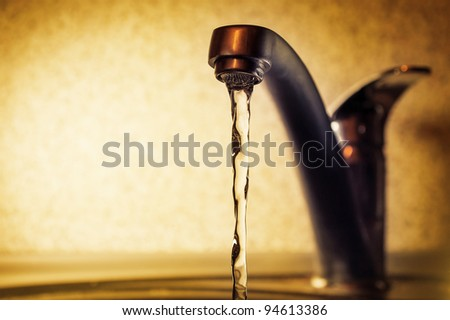 water leakage from the tap - stock photo