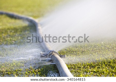 water leaking from hole in a hose - stock photo
